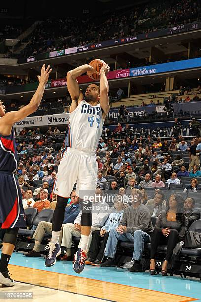 Jeffery Taylor of the Charlotte Bobcats shoots against the Atlanta Hawks during the game at the Time Warner Cable Arena on November 11 2013 in...