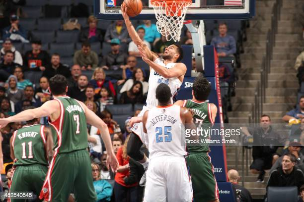 Jeffery Taylor of the Charlotte Bobcats shoots against the Milwaukee Bucks during the game at the Time Warner Cable Arena on November 29 2013 in...