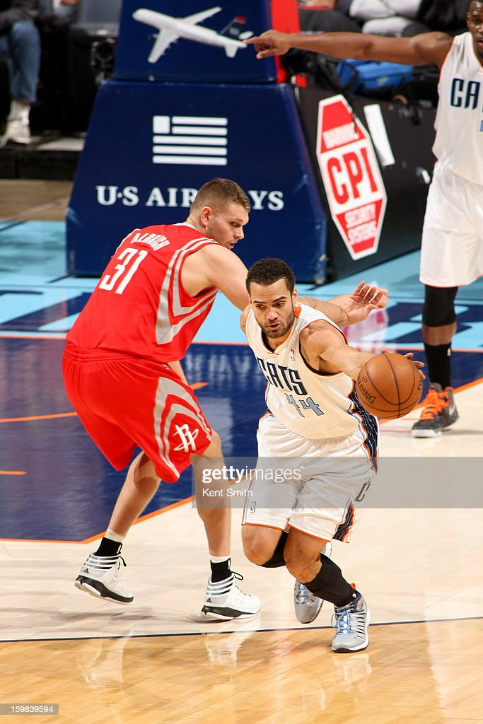 Jeffery Taylor #44 of the Charlotte Bobcats steals the ball against Cole Aldrich #31 of the Houston Rockets at the Time Warner Cable Arena on January 21, 2013 in Charlotte, North Carolina.