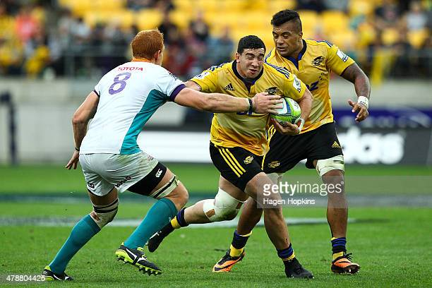 Jeffery ToomagaAllen of the Hurricanes fends Philip van der Walt of the Cheetahs during the round five Super Rugby match between the Hurricanes and...