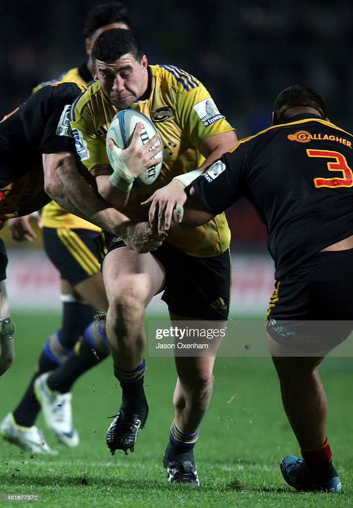 Jeffery Toomaga-Allen of the Hurricanes is tackled by Ben Tameifuna of the Chiefs during the round 18 Super Rugby match between the Chiefs and the Hurricanes at Waikato Stadium on July 4, 2014 in Hamilton, New Zealand.