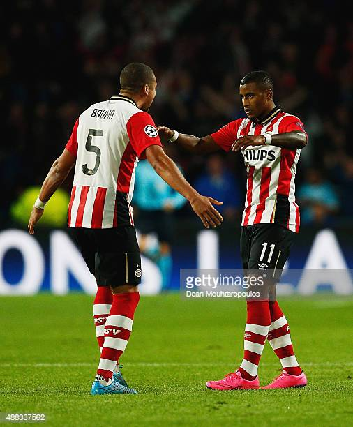 Jeffrey Bruma and Luciano Narsingh of PSV Eindhoven celebrate victory after the UEFA Champions League Group B match between PSV Eindhoven and...