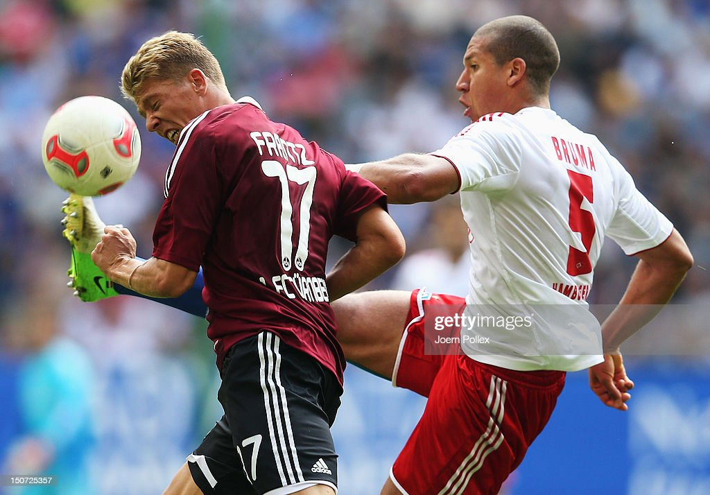 <a gi-track='captionPersonalityLinkClicked' href=/galleries/search?phrase=Jeffrey+Bruma&family=editorial&specificpeople=4508935 ng-click='$event.stopPropagation()'>Jeffrey Bruma</a> (R) of Hamburg and <a gi-track='captionPersonalityLinkClicked' href=/galleries/search?phrase=Mike+Frantz&family=editorial&specificpeople=5633011 ng-click='$event.stopPropagation()'>Mike Frantz</a> of Nuernberg compete for the ball during the Bundesliga match between Hamburger SV and 1. FC Nuernberg at Imtech Arena on August 25, 2012 in Hamburg, Germany.