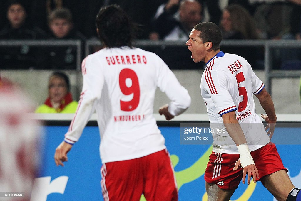 <a gi-track='captionPersonalityLinkClicked' href=/galleries/search?phrase=Jeffrey+Bruma&family=editorial&specificpeople=4508935 ng-click='$event.stopPropagation()'>Jeffrey Bruma</a> (R) of Hamburg celebrates after scoring his team's first goal during the Bundesliga match between Hannover 96 and Hamburger SV at AWD Arena on November 26, 2011 in Hanover, Germany.