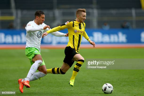 Jeffrey Bruma of Wolfsburg challenges Marco Reus of Dortmund during the Bundesliga match between Borussia Dortmund and VfL Wolfsburg at Signal Iduna...