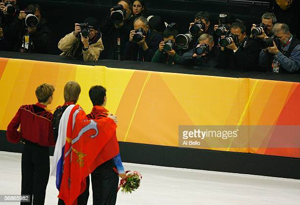 Jeffrey Buttle of Canda Evegeni Plushenko of Russia and Stephane Lambiel of Switzerland pose for photographers after receiving their medals for Men's...