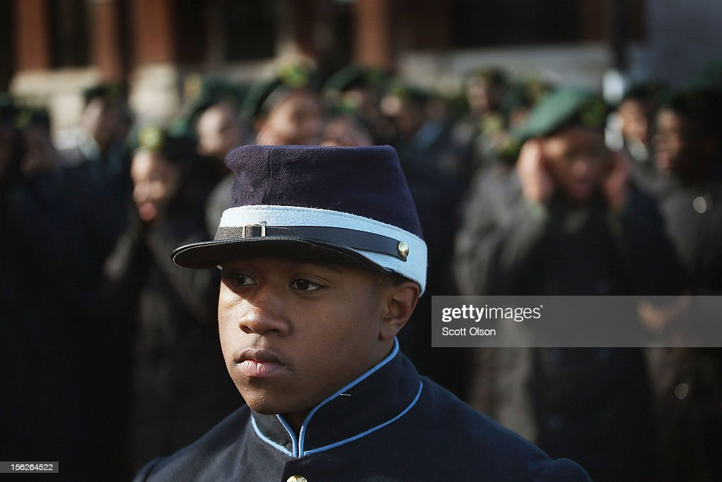 Jeffrey Carodine and other students from the Chicago Military Academy participate in the Chicago Veterans Day parade on November 12, 2012 in Chicago, Illinois. Veterans Day, held the anniversary of the signing of the armistice which ended the World War I, is celebrated to honor all veterans for their service.
