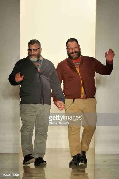 Jeffrey Costello and Robert Tagliapietra acknowledge the crowd at the end of the Costello Tagliapietra Fall 2011 fashion show during MercedesBenz...