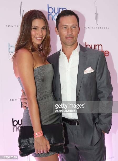 Jeffrey Donovan and Michelle Woods arrive at wrap party for 'Burn Notice' at Fontainebleau Miami Beach on July 27 2013 in Miami Beach Florida