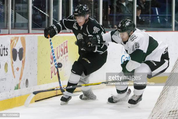 Jeffrey Durocher of the Gatineau Olympiques battles for the puck against Quinn Hanna of the BlainvilleBoisbriand Armada on October 13 2017 at Robert...