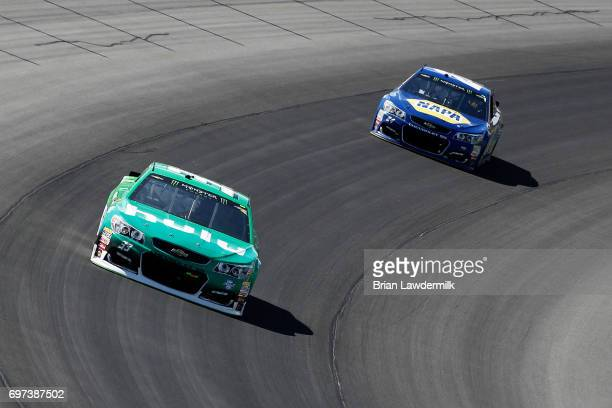 Jeffrey Earnhardt driver of the Hulu Chevrolet leads Chase Elliott driver of the NAPA Chevrolet during the Monster Energy NASCAR Cup Series...