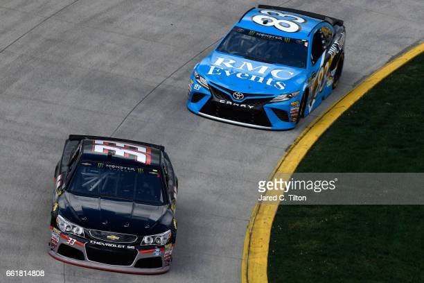 Jeffrey Earnhardt driver of the Little Joes Autos/Curtis Key Plumbing Chevrolet and Corey LaJoie driver of the RMC Events Toyota practice for the...