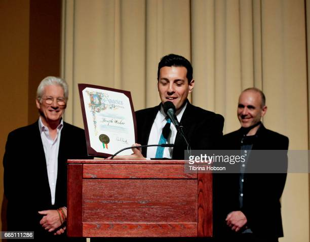 Jeffrey Ebenstein presents Richard Gere and Joseph Cedar with the city of Los Angeles Proclamation at the premiere and prereception for Sony Pictures...