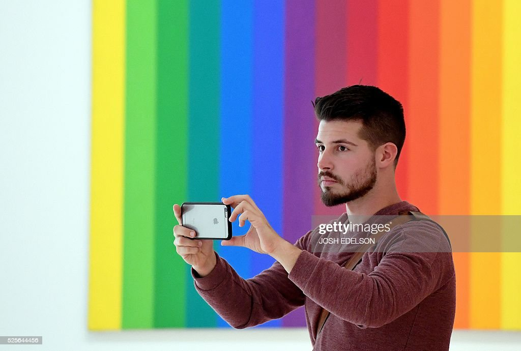 Jeffrey Gerson takes a photo inside the San Francisco Museum of Modern Art (SFMOMA) in San Francisco, California on April 28, 2016. The newly redesigned museum integrates a 10-story expansion in a new building and will open to the public on May 14, 2016. / AFP / Josh Edelson / RESTRICTED