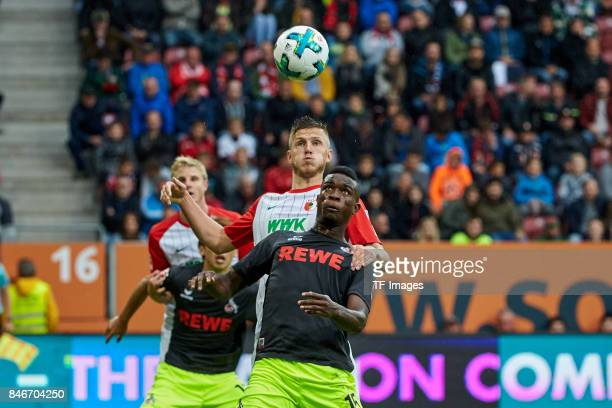 Jeffrey Gouweleeuw of Augsburg and Jhon Cordoba of Koeln battle for the ball during the Bundesliga match between FC Augsburg and 1 FC Koeln at...