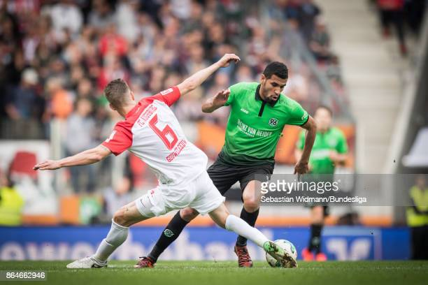 Jeffrey Gouweleeuw of Augsburg and Jonathas de Jesus of Hannover 96 compete for the ball during the Bundesliga match between FC Augsburg and Hannover...