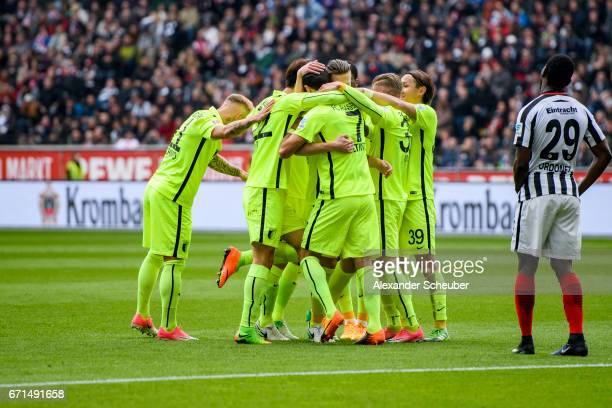 Jeffrey Gouweleeuw of Augsburg celebtrates the first goal for his team with his teammates during the Bundesliga match between Eintracht Frankfurt and...