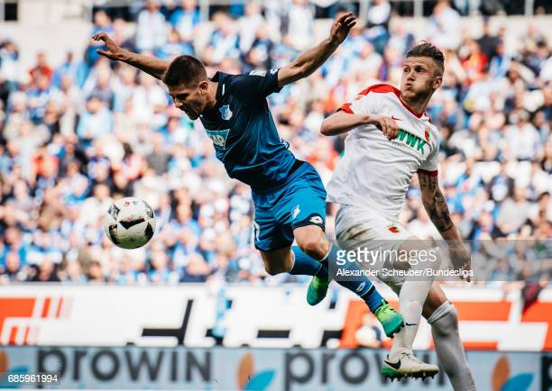 Jeffrey Gouweleeuw of Augsburg challenges Andrej Kramaric of Hoffenheim during the Bundesliga match between TSG 1899 Hoffenheim and FC Augsburg at...