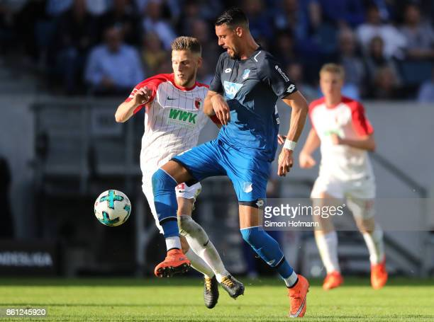 Jeffrey Gouweleeuw of Augsburg fights for the ball with Sandro Wagner of Hoffenheim during the Bundesliga match between TSG 1899 Hoffenheim and FC...