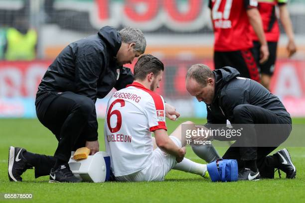Jeffrey Gouweleeuw of Augsburg on the ground during the Bundesliga match between FC Augsburg and SC Freiburg at WWK Arena on March 18 2017 in...