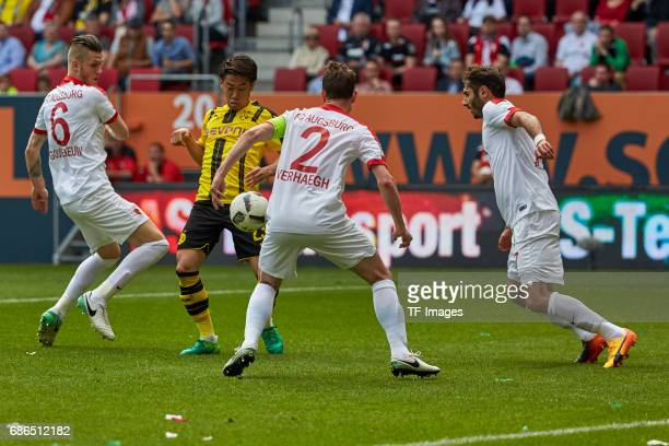 Jeffrey Gouweleeuw of Augsburg Paul Verhaegh of Augsburg und Halil Altintop of Augsburg and Shinji Kagawa of Dortmund battle for the ball during the...