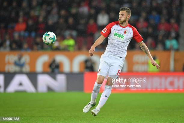 Jeffrey Gouweleeuw of Augsburg plays the ball during the Bundesliga match between FC Augsburg and RB Leipzig at WWKArena on September 19 2017 in...