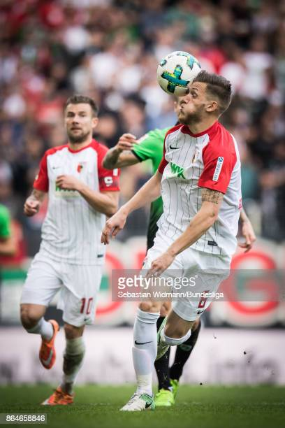 Jeffrey Gouweleeuw of Augsburg plays the ball during the Bundesliga match between FC Augsburg and Hannover 96 at WWKArena on October 21 2017 in...