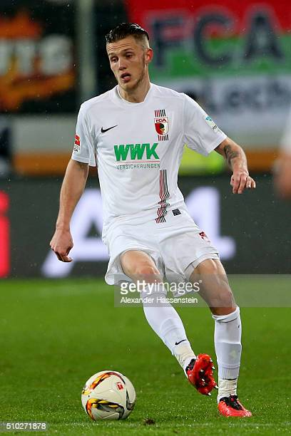 Jeffrey Gouweleeuw of Augsburg runs with the ball during the Bundesliga match between FC Augsburg and FC Bayern Muenchen at WWK Arena on February 14...