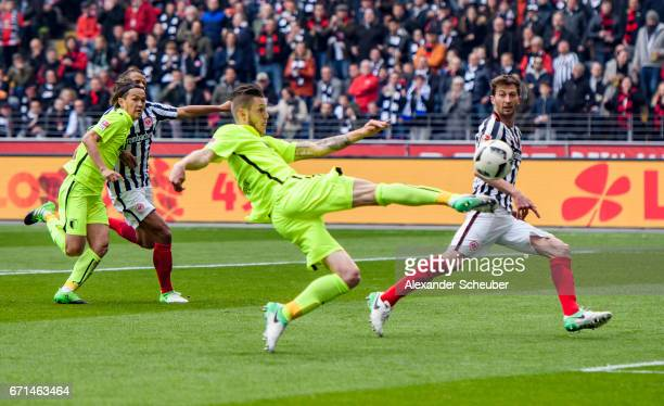 Jeffrey Gouweleeuw of Augsburg scores the first goal for his team during the Bundesliga match between Eintracht Frankfurt and FC Augsburg at...
