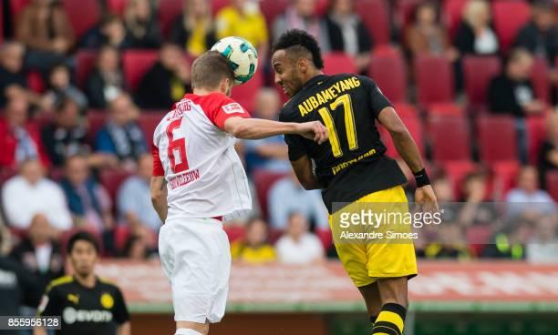 Jeffrey Gouweleeuw of FC Augsburg and PierreEmerick Aubameyang of Borussia Dortmund during the Bundesliga match between FC Augsburg and Borussia...