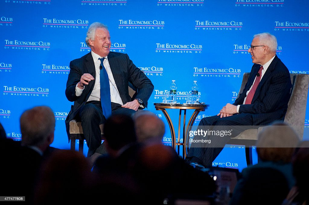 Jeffrey 'Jeff' Immelt, chairman and chief executive officer of General Electric Co. (GE), left, laughs while speaking with David Rubenstein, co-founder and co-chief executive officer of the Carlyle Group LP, at the Economic Club of Washington in Washington, D.C., U.S., on Wednesday, June 17, 2015. Immelt threatened to move U.S. jobs overseas if Congress doesn't reauthorize the Export-Import Bank's charter, which expires at the end of June. Photographer: Pete Marovich/Bloomberg via Getty Images