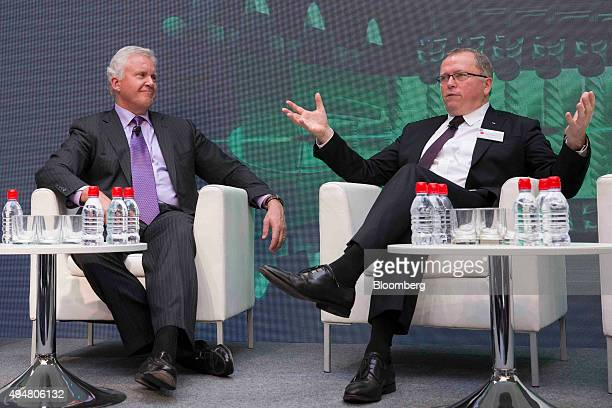 Jeffrey 'Jeff' Immelt chairman and chief executive officer of General Electric Co left listens as Eldar Saetre chief executive officer of Statoil ASA...