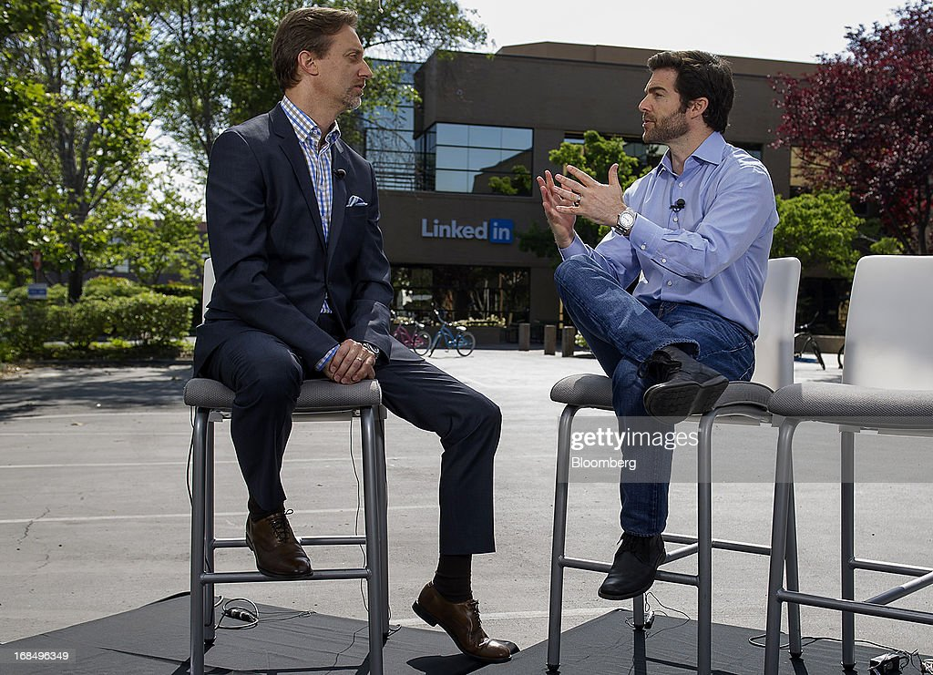 Jeffrey 'Jeff' Weiner, chief executive officer of LinkedIn Corp., right, speaks with Bloomberg West Editor-at-Large Cory Johnson during a Bloomberg West television interview outside of the company's headquarters in Mountain View, California, U.S., on Thursday, May 9, 2013. The business-oriented network, which is celebrating its 10th anniversary, reported that revenue for the first-quarter of 2103 was $324.7 million, up from $188.5 million in the first quarter of 2012. Photographer: David Paul Morris/Bloomberg via Getty Images