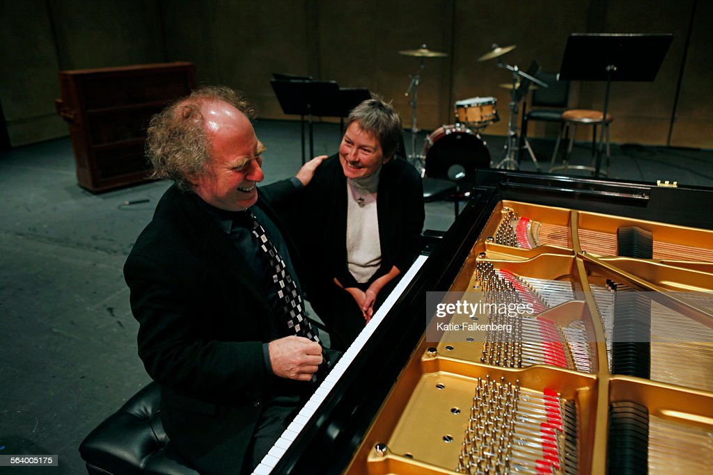Jeffrey Kahane pianist and conductor pats Teri Meredyth a piano technician after he played the piano 'Sapphire' after Meredyth tuned and voiced it...