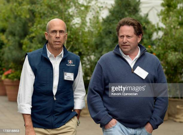 Jeffrey Katzenberg film producer and CEO of DreamWorks Animation and Bobby Kotick CEO president of Activision walk in Sun valley Village during Allen...