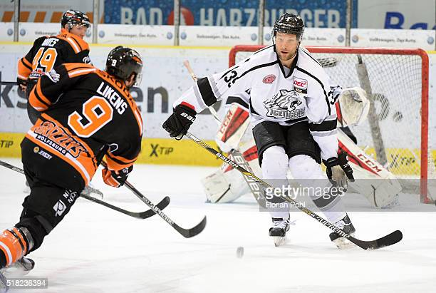 Jeffrey Likens of Grizzlys Wolfsburg and David Steckel of the Thomas Sabo Ice Tigers Nuernberg during the game between Grizzlys Wolfsburg and Thomas...