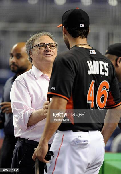 Jeffrey Loria owner of the of the Miami Marlins talks to Garrett Jones before the game against the Washington Nationals at Marlins Park on Wednesday...