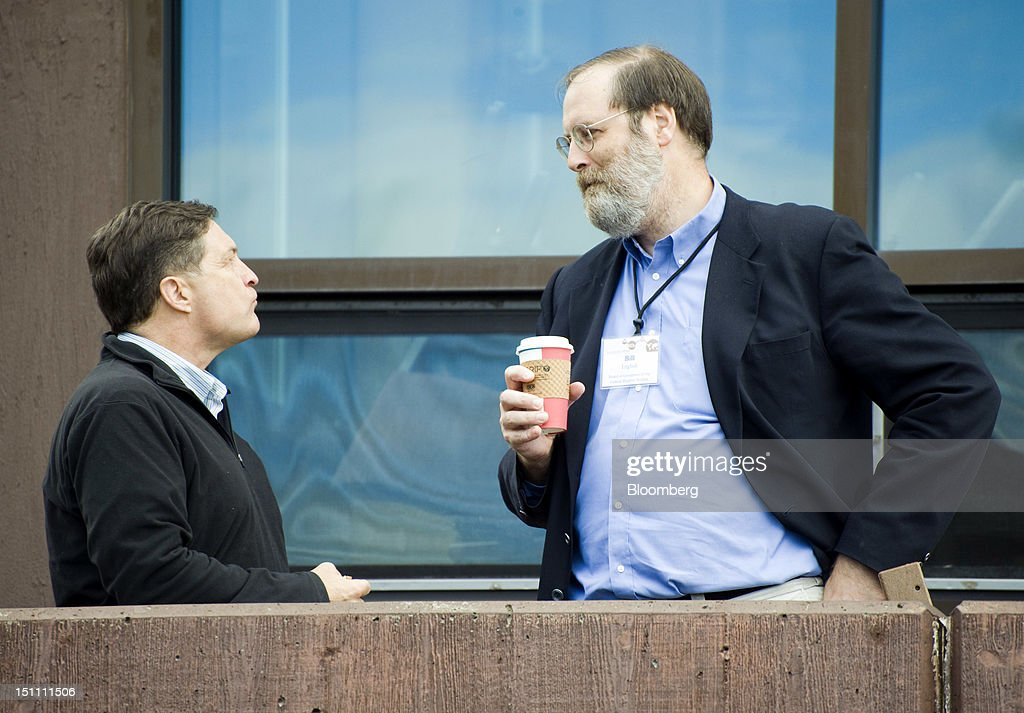 Jeffrey M. Lacker, president and chief executive officer of the Federal Reserve Bank of Richmond, left, speaks with William B. English, director of monetary affairs for the board of governors of the Federal Reserve System, during a break in the morning session at the economic symposium sponsored by the Kansas City Federal Reserve Bank at the Jackson Lake Lodge in Moran, Wyoming, U.S., on Saturday, Sept. 1, 2012. Ben S. Bernanke, chairman of the U.S. Federal Reserve, with a little more than a year left in his second term, defended the effectiveness of unconventional monetary policies such as bond purchases and signaled he would soon deploy them again to attack unemployment. Photographer: Price Chambers/Bloomberg via Getty Images