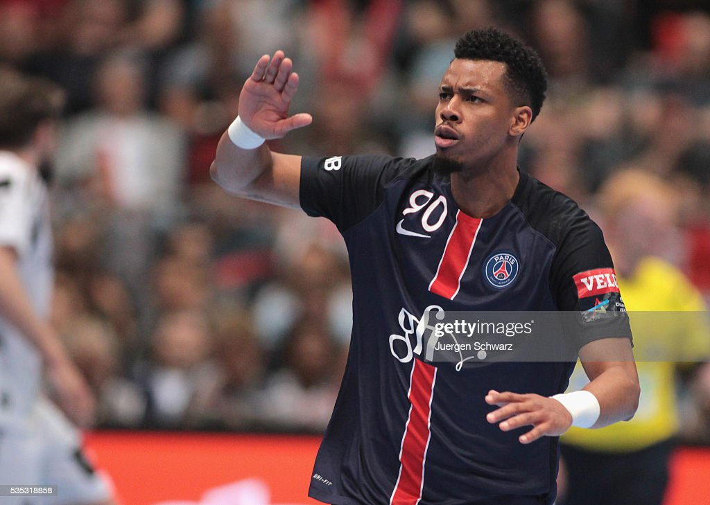 Jeffrey Mtima of Paris celebrates after scoring during the third place play-off at the EHF Final4 between Paris St.-Germain and THW Kiel on May 29, 2016 in Cologne, Germany.