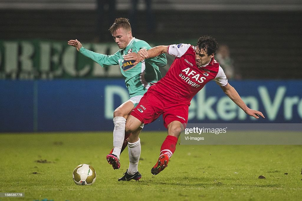 Jeffrey Rijsdijk of FC Dordrecht, Dirk Marcellis of AZ during the Dutch Cup match between FC Dordrecht and AZ Alkmaar at the GN Bouw Stadium on December 18, 2012 in Dordrecht, The Netherlands.