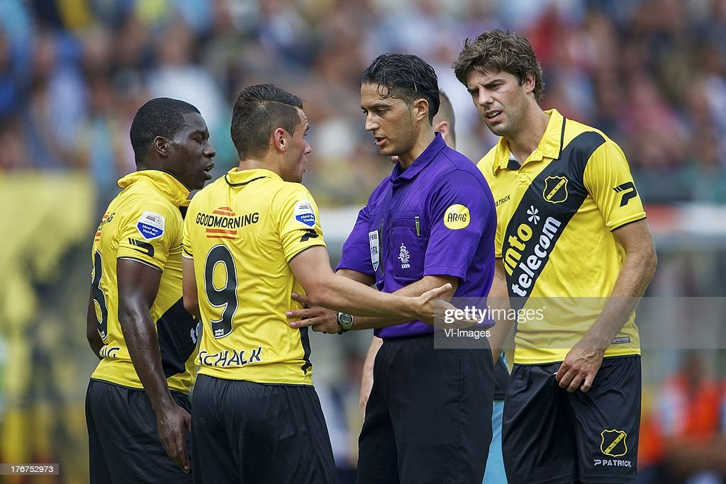 Jeffrey Sarpong of NAC Breda, Alex Schalk of NAC Breda, referee Serdar Gozubuyuk, Kees Kwakman of NAC Breda during the Dutch Eredivisie match between NAC Breda and ADO Den Haag on August 18, 2013 at the Rat Verlegh stadium in Breda, The Netherlands.