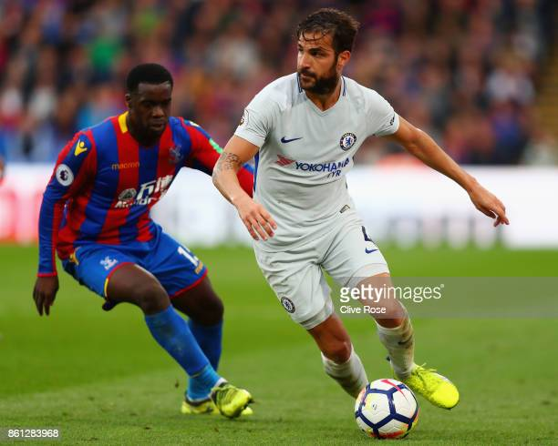 Jeffrey Schlupp of Crystal Palace chases down Cesc Fabregas of Chelsea during the Premier League match between Crystal Palace and Chelsea at Selhurst...