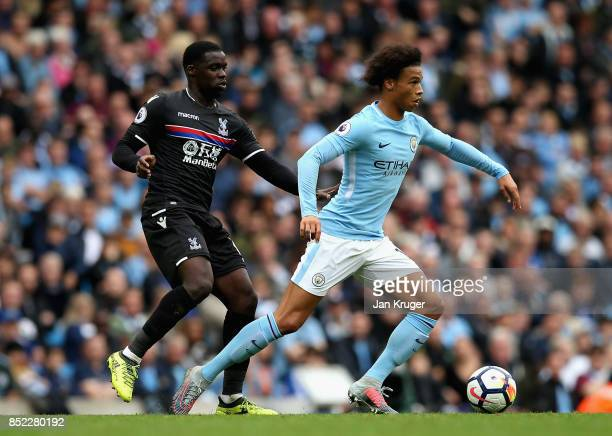 Jeffrey Schlupp of Crystal Palace puts pressure on Leroy Sane of Manchester City during the Premier League match between Manchester City and Crystal...