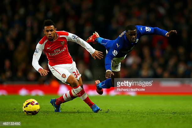 Jeffrey Schlupp of Leicester City battles for the ball with Francis Coquelin of Arsenal during the Barclays Premier League match between Arsenal and...