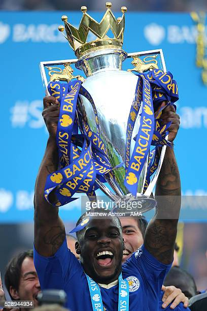 Jeffrey Schlupp of Leicester City lifts the Premier League Trophy as Leicester City celebrate becoming Premier League Champions for the 2015/16...