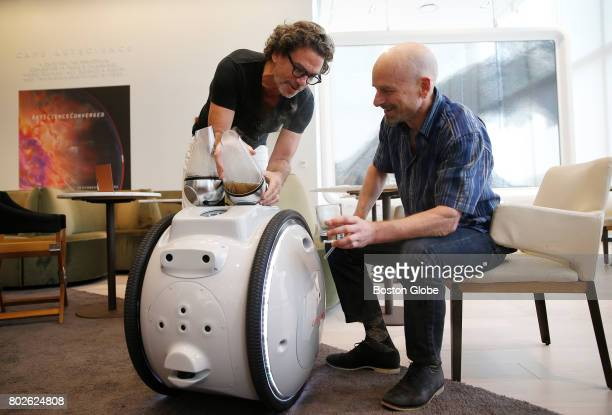 Jeffrey Schnapps founder of Piaggio Fast Forward right poses for a portrait with serial inventor David Edwards left and Cafe Gita a robot at Cafe...