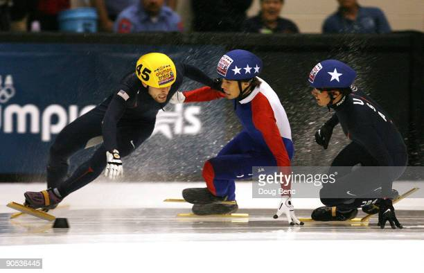 Jeffrey Simon gets tangled up with Apolo Anton Ohno as JR Celski looks on during the Men's 500 final at the US Short Track Speedskating Championships...