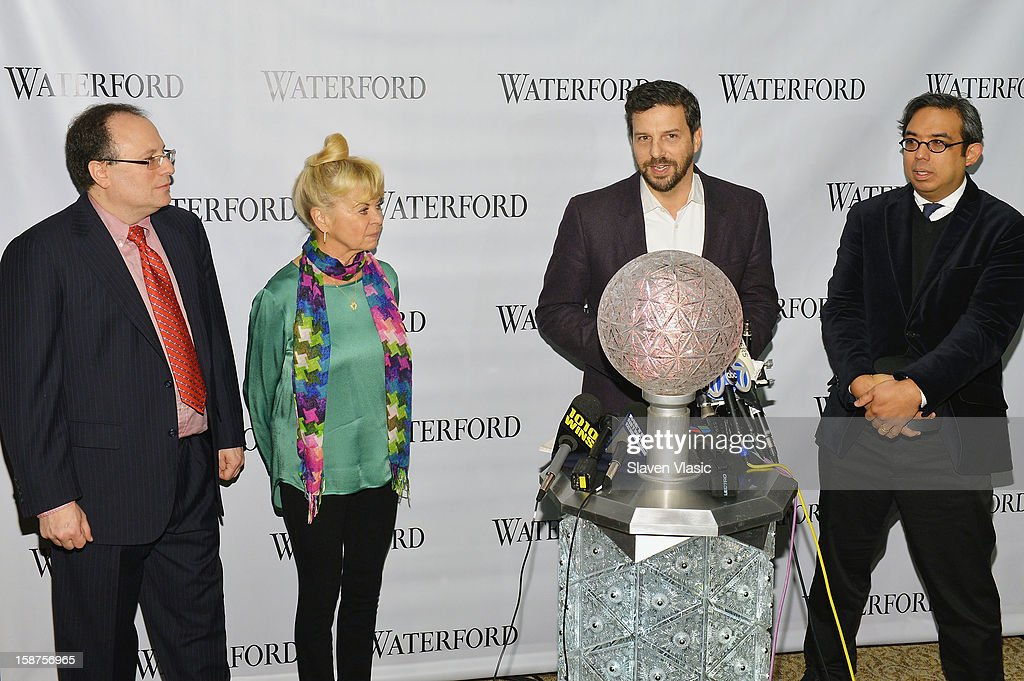 Jeffrey Straus, Kari Clark, Tim Tompkins and Regan Iglesia attend the installation of 288 New Waterford Crystals on the 2013 Times Square New Year's Eve Ball at One Times Square on December 27, 2012 in New York City.