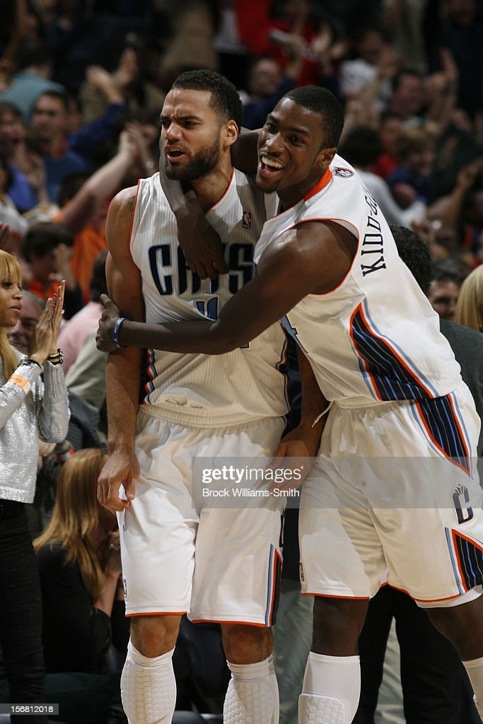 Jeffrey Taylor #44 and <a gi-track='captionPersonalityLinkClicked' href=/galleries/search?phrase=Michael+Kidd-Gilchrist&family=editorial&specificpeople=8526214 ng-click='$event.stopPropagation()'>Michael Kidd-Gilchrist</a> #14 of the Charlotte Bobcats celebrate the win against the Toronto Raptors at the Time Warner Cable Arena on November 21, 2012 in Charlotte, North Carolina.