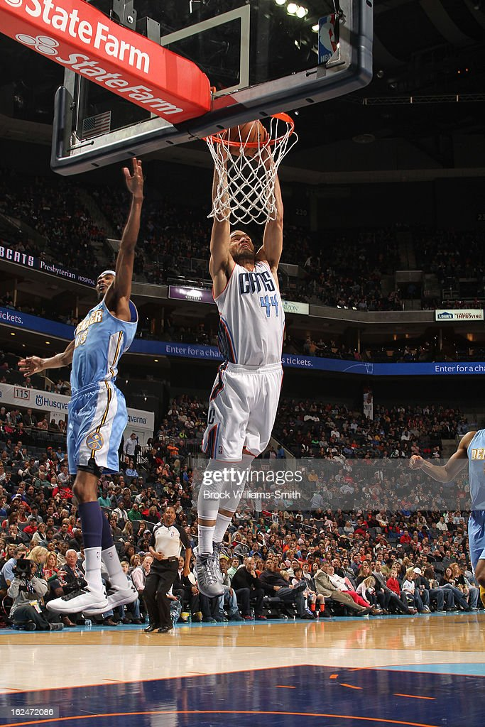 Jeffrey Taylor #44 of the Charlotte Bobcats dunks against Corey Brewer #13 of the Denver Nuggets at the Time Warner Cable Arena on February 23, 2013 in Charlotte, North Carolina.